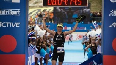 Photo of Clemente Alonso and Eva Wutti break the clock at the IROMAN Barcelona