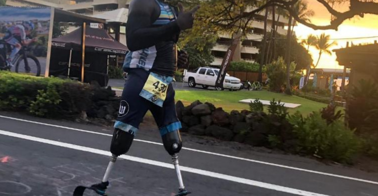 the first triathlete amputated above the knees to complete the IRONMAN Hawaii