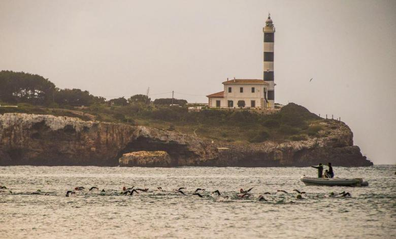 Triathlon Portocolom swimming with the lighthouse in the background