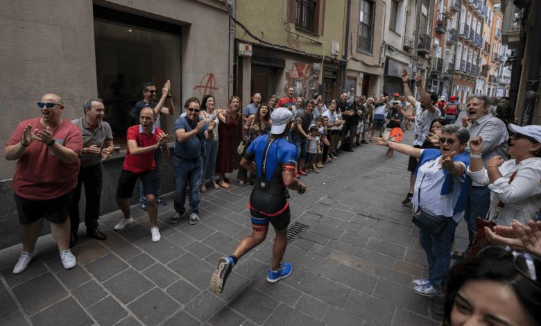 a triathlete passing through the streets of Vitoria